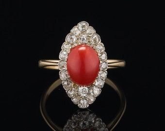 Art Deco 1.25 Ct natural red coral and 2.26 Ct diamond navette smashing ring