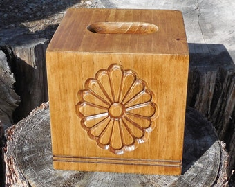 Handmade tissue box cover with hand carved Spanish flower in medium wood finish.