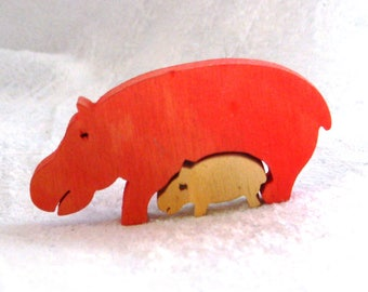 Small plywood mother and baby hippopotamus