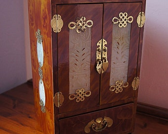 Vintage jewelry chest in oriental style, wooden jewelry box.