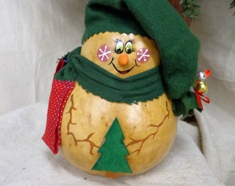 Hand crafted and hand painted primitive gourd art snowman in forest green scarf and hat by Debbie Easley
