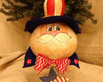 hand painted gourd Uncle Sam mounted on bed spring with red, white and blue hat Fourth of July decoration by Debbie Easley