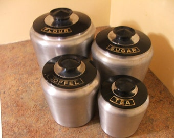 Set of Four (4) Kromex 1950s / 1960s Aluminum Canisters with Black Lids
