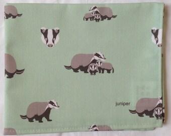 Badger tea towel - badger kitchen towel - badger print on green background - in 100% cotton