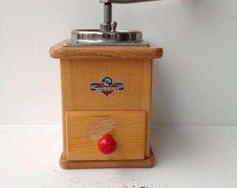 Wooden vintage coffee mill, working