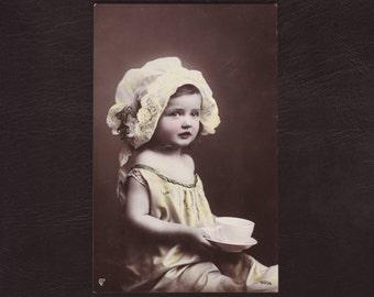 Little girl in unusual art nouveau headdress, German hand tinted photo postcard - Children, rppc,hat, antique greeting card - 1905 (V4-69)