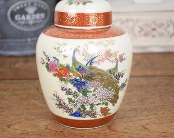 Vintage Japanese ceramic ginger jar with traditional oriental peacock design
