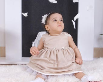 Baby cerimonial dress in beige with flowers on front