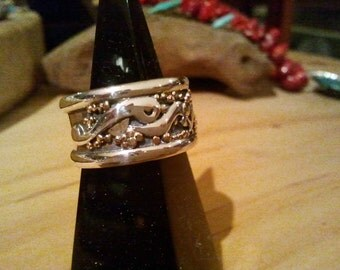 Gold (9ct rose) and sterling  silver ring
