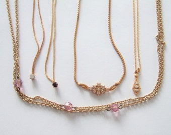 Beautiful Set Of Five Vintage Gold Metal French Necklaces Measuring From Over 15 Inches To 52 Inches Long.