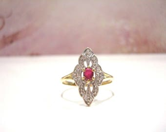Amazing 18 Carat Yellow And White Gold Ruby Diamond Marquise Ring.