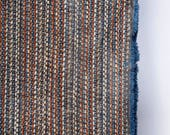 Blue and rust striped sof...