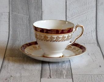 Royal Stafford Bone China Burgundy and Gold Tea Cup and Saucer