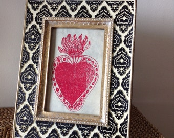 Authentic Mexican Sacred Heart in a Gold 4x6 frame with Black and White Carved Details. Red Sacred Heart printed on fiber paper.