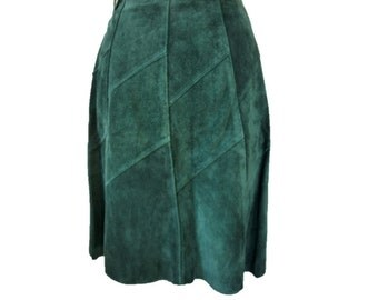 Suede skirt in bottle green colour. Vintage 1970's flared knee length skirt with diagonal patch detailing. Size 8