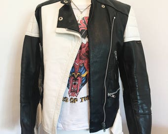 Genuine leather motorcycle jacket, black and white in excellent vintage condition, very unique style