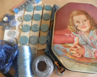 Vintage sewing kit in 1950's tin, old buttons, threads, anchor sewing cotton