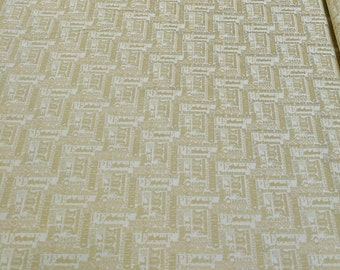 Holiday Editions Christmas Words-Tan and Gold Cotton Fabric by Fabri-Quilt