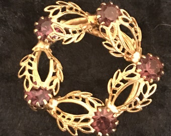 Vintage Gold Tone Filigree with Purple Rhinestones Brooch