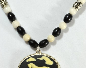 Horse Cameo on black, white and metal necklace