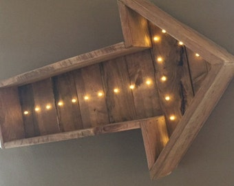 Rustic lighted wooden arrow