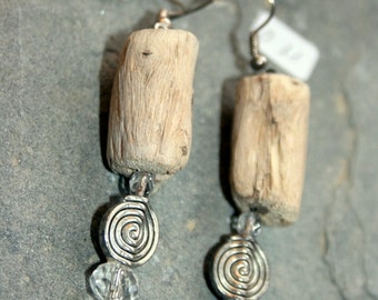 Earrings in bright North driftwood and silver-plated screw element.     O11