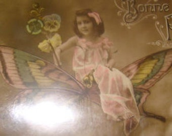 Vintage Hand Tinted RPPC Of Girl On A Butterfly