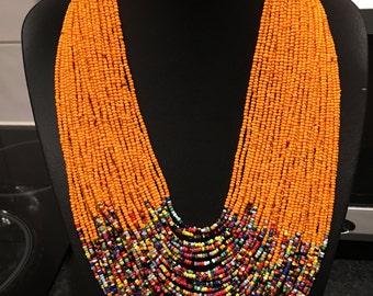 Orange beaded multi strand necklace