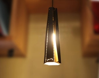 Contemporary steel black matte and gold assemblage pendant lamp by magnets