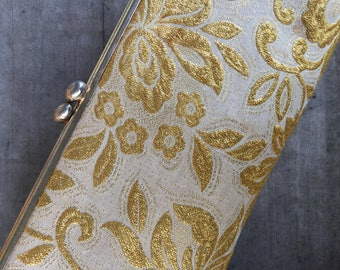 white & gold evening bag