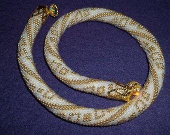 Beaded white and golden necklace