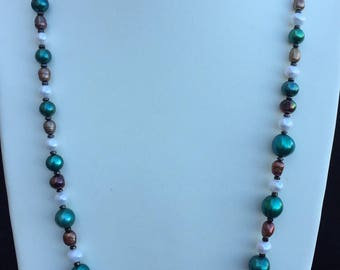 Freshwater pearl necklace in bottle green brown and white.