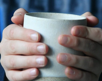 Wheelthrown stoneware mug in a matte white glaze