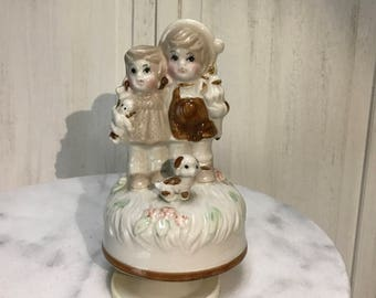 vintage music, boy and girl and their cute dog, working music box, plays raindrops keep falling on my head, adorable