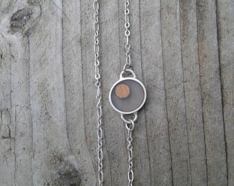 Asymmetrical silver circle necklace with bamboo wood and cast resin