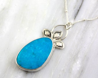 Nakozari Turquoise and Stamped Fleur Silver Necklace
