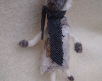 Needle felted sheep. 'The herring bone pattern in her scarf...'