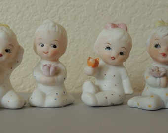 4 Porcelain Miniature Baby Figurines