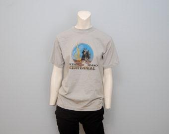 Vintage 1985 Official North Dakota Centennial 100th Anniversary Celebration T-Shirt Size Medium Gray 80's Retro Shirt Tshirt