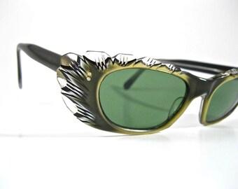 Vintage carved gold cat eye sunglasses. Ornate eyeglass frames w/ non-prescription lenses. Frame France.