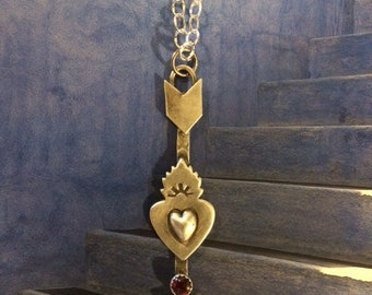 Sterling Silver Arrow Heart Pendant with a Garnet cabinet