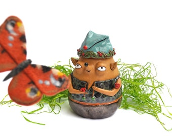 Ceramic holder for loose goodies: forester babooshi holding tamed ladybugs