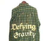 Defying Gravity Shirt in Green Plaid Flannel. Wicked musical song quote theatre thespian geek hipster grunge acid washed bleached ooak witch