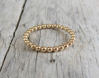 Gold ring. Dotted band in gold filled or sterling silver. Fancy stacking ring.
