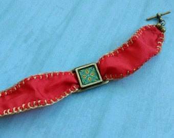 Spanish Tile Bracelet, Turquoise and Red, on Red Silk with Metallic Gold Blanket Stitching and a Gold-plated Brass Toggle Clasp