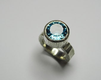 Artemis ring with blue topaz