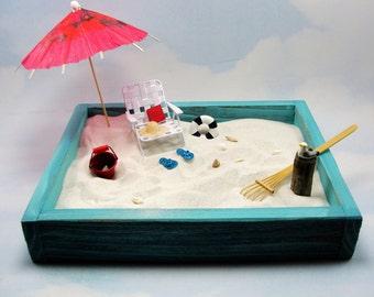 miniature zen beach garden kit, metal chair, straw hat, book, beverage, bucket, shells and more