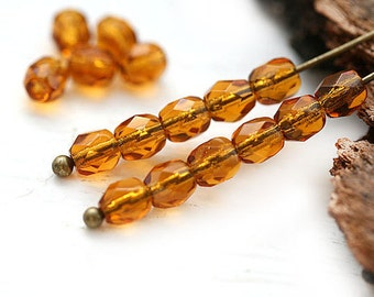 Amber topaz Czech glass beads, Brown, Fire polished round faceted spacers - 4mm - 50Pc - 0802