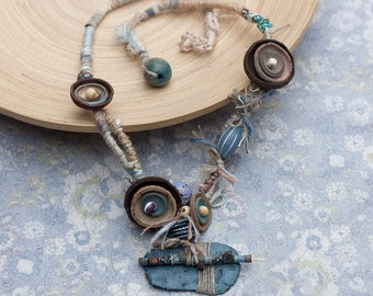 Mixed media necklace in blue and brown Tribal statement jewelry, Fiber art necklace with twig, clay, leather and wooden beads, OOAK