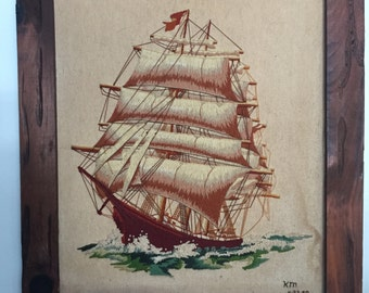Embroidered ship in wooden frame